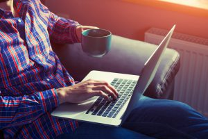 Newsletter background - Man with coffee and laptop